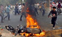 A motorbike burns as activists of Islamist party, Jamaat-e-Islami, set fire to vehicles in their protest against the execution of their party leader Abdul Quader Mollah in Dhaka, Bangladesh, Friday, Dec. 13, 2013. The execution of the opposition leader in Bangladesh sparked violent protests Friday as activists torched homes and businesses belonging to government supporters, leaving at least three people dead, in a fresh wave of bloodshed ahead of elections next month. (AP Photo/Reaz Ahmed Sumon)