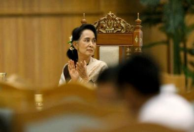 National League for Democracy (NLD) party leader Aung San Suu Kyi applauds as she attends a farewell ceremony at the Parliament in Naypyitaw
