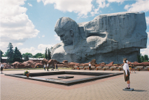 The main monument at the Brest Fortress Complex, modelled after the image of a Soviet combatant, rises above the eternal flame and the memorial to the Soviet hero-cities (adorned by red flowers). The monument pays tribute to the Belarusian soldiers who fought honorably during the Great Patriotic War (World War II).